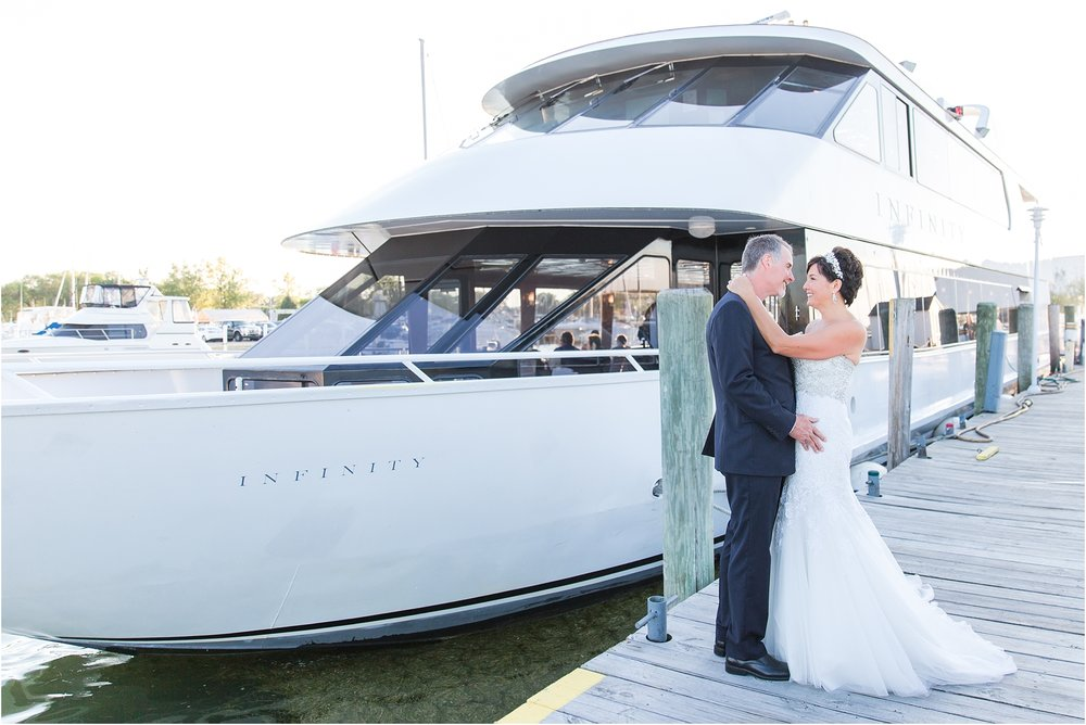classic-natuical-inspired-wedding-photos-on-infinity-ovation-yacht-in-st-clair-shores-mi-by-courtney-carolyn-photography_0073.jpg