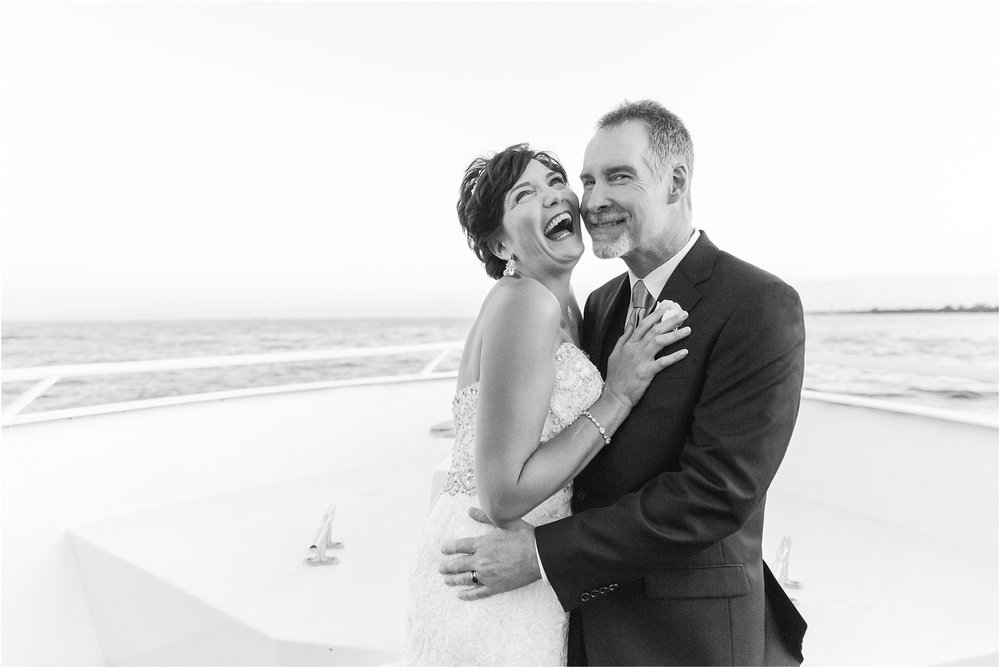 classic-natuical-inspired-wedding-photos-on-infinity-ovation-yacht-in-st-clair-shores-mi-by-courtney-carolyn-photography_0079.jpg