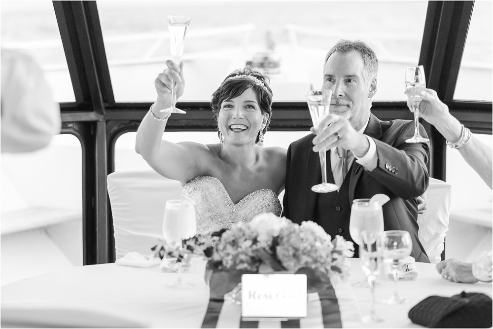classic-natuical-inspired-wedding-photos-on-infinity-ovation-yacht-in-st-clair-shores-mi-by-courtney-carolyn-photography_0085.jpg