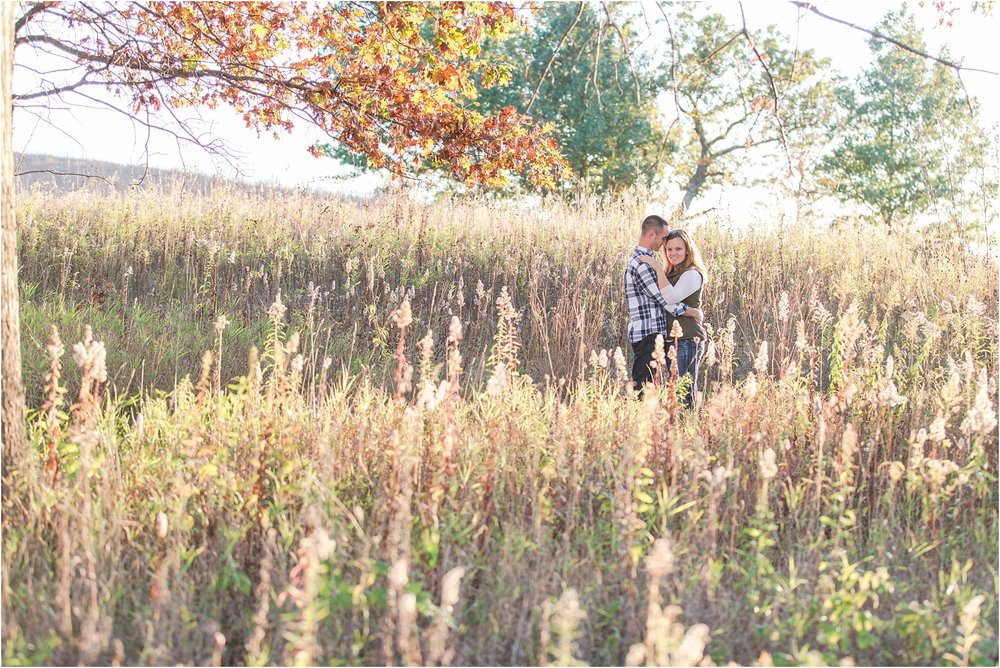 romantic-fall-engagement-photos-at-indian-springs-metropark-in-clarkston-mi-by-courtney-carolyn-photography_0006.jpg