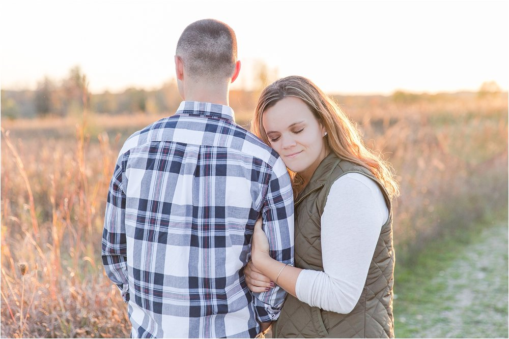romantic-fall-engagement-photos-at-indian-springs-metropark-in-clarkston-mi-by-courtney-carolyn-photography_0008.jpg