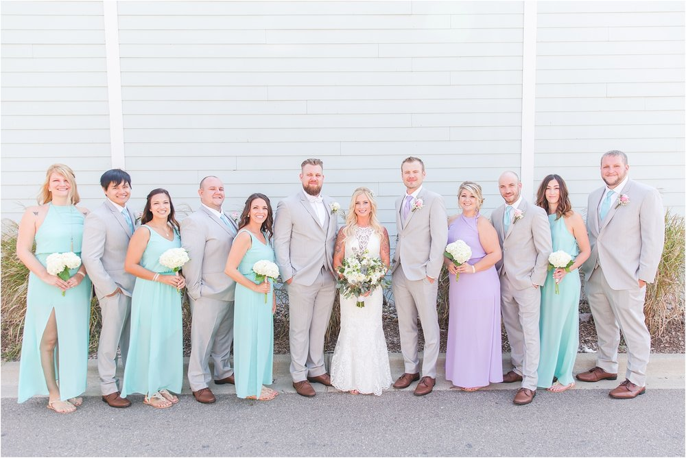 fun-whimsical-beach-wedding-photos-in-st-joseph-michigan-by-courtney-carolyn-photography_0038.jpg
