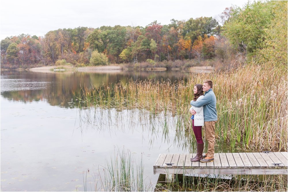 colorful-fall-engagement-photos-at-the-lake-at-huron-meadows-metropark-in-brighton-michigan-by-courtney-carolyn-photography_0005.jpg
