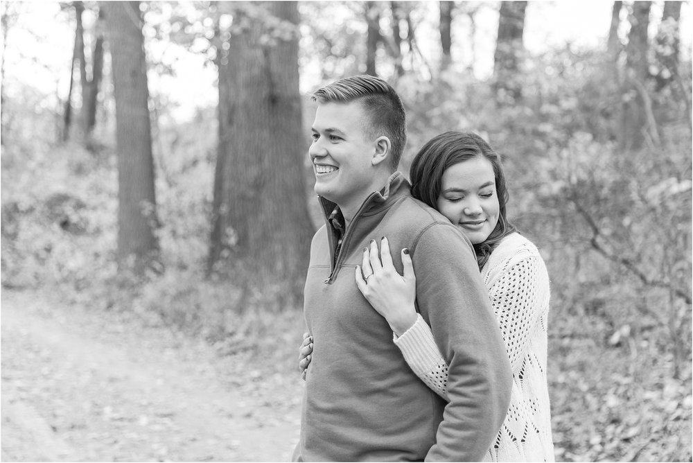 colorful-fall-engagement-photos-at-the-lake-at-huron-meadows-metropark-in-brighton-michigan-by-courtney-carolyn-photography_0009.jpg