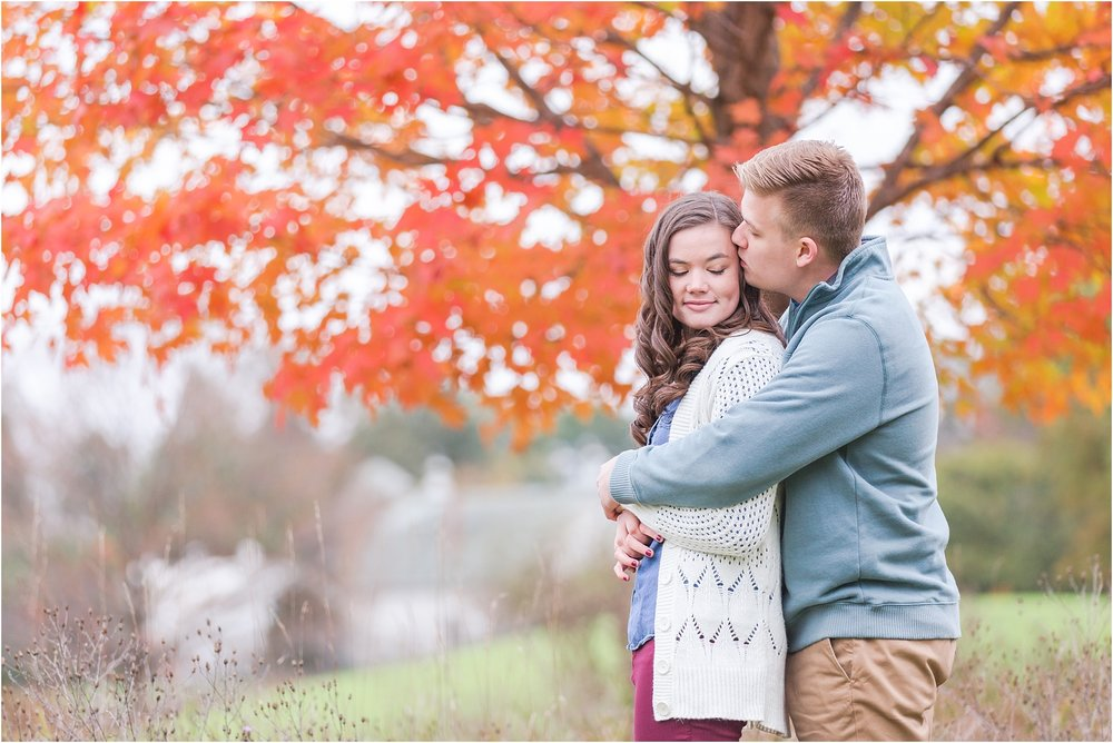 colorful-fall-engagement-photos-at-the-lake-at-huron-meadows-metropark-in-brighton-michigan-by-courtney-carolyn-photography_0022.jpg