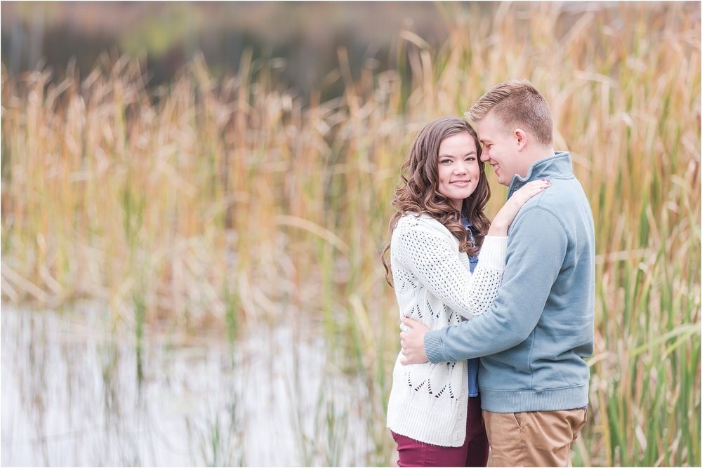 colorful-fall-engagement-photos-at-the-lake-at-huron-meadows-metropark-in-brighton-michigan-by-courtney-carolyn-photography_0024.jpg
