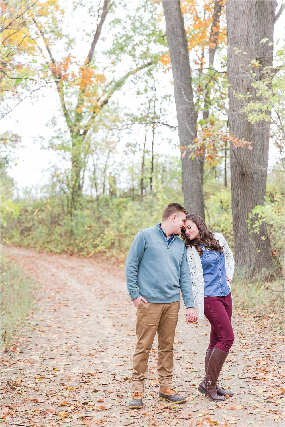 colorful-fall-engagement-photos-at-the-lake-at-huron-meadows-metropark-in-brighton-michigan-by-courtney-carolyn-photography_0023.jpg