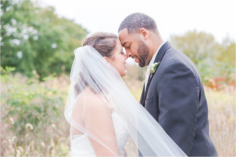 elegant-and-romantic-fall-wedding-photos-at-st-marys-catholic-church-in-monroe-michigan-by-courtney-carolyn-photography_0061.jpg