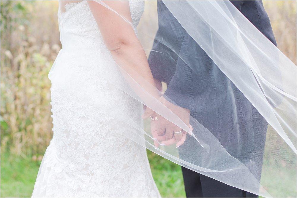 elegant-and-romantic-fall-wedding-photos-at-st-marys-catholic-church-in-monroe-michigan-by-courtney-carolyn-photography_0064.jpg