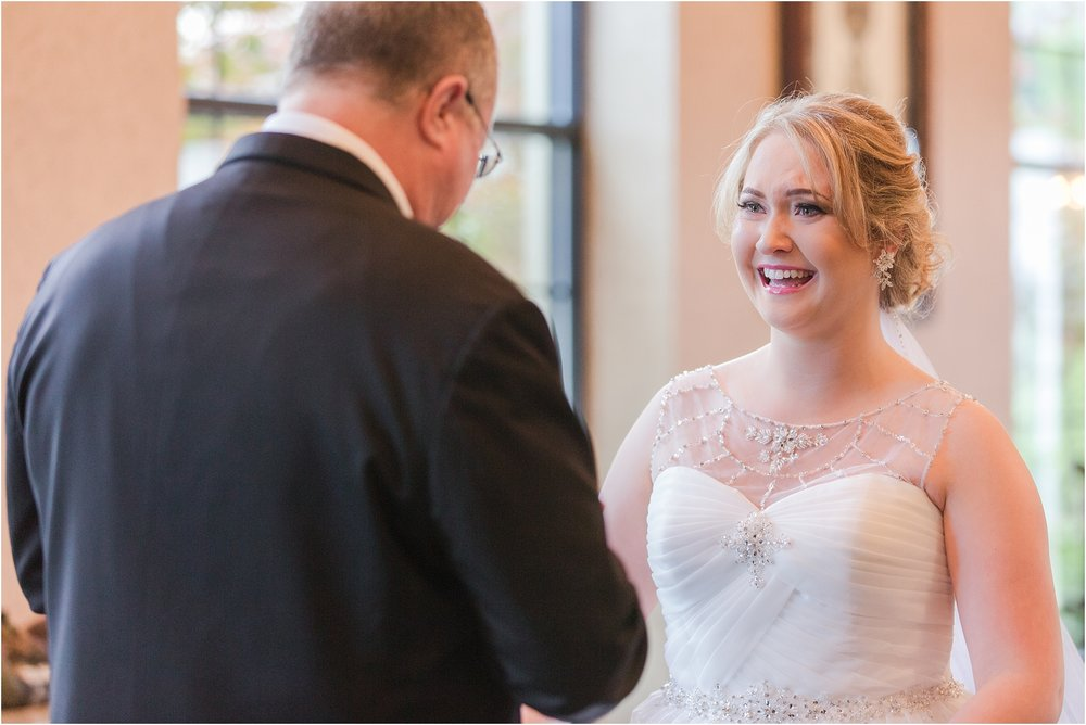 father-and-bride-share-emotional-first-look-on-wedding-day-photos-in-detroit-michigan-by-courtney-carolyn-photography_0005.jpg
