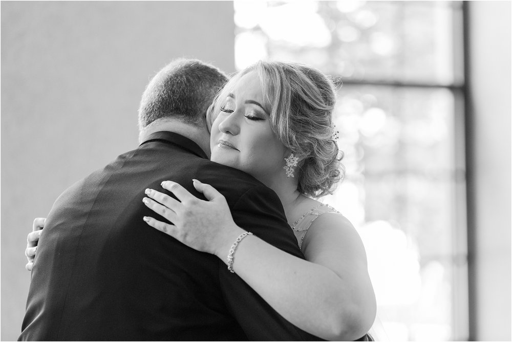father-and-bride-share-emotional-first-look-on-wedding-day-photos-in-detroit-michigan-by-courtney-carolyn-photography_0007.jpg