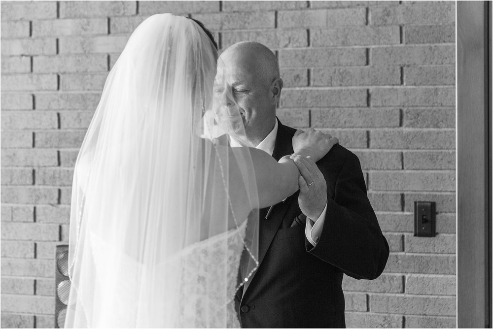 father-and-bride-share-emotional-first-look-on-wedding-day-photos-in-detroit-michigan-by-courtney-carolyn-photography_0031.jpg