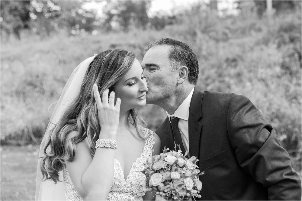 father-and-bride-share-emotional-first-look-on-wedding-day-photos-in-detroit-michigan-by-courtney-carolyn-photography_0070.jpg