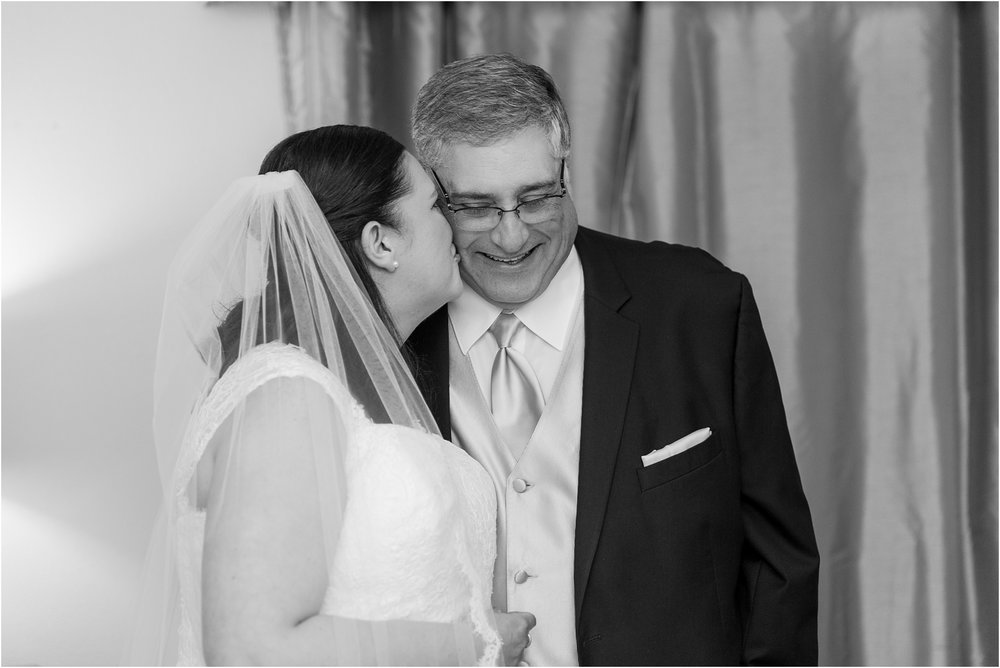 father-and-bride-share-emotional-first-look-on-wedding-day-photos-in-detroit-michigan-by-courtney-carolyn-photography_0075.jpg