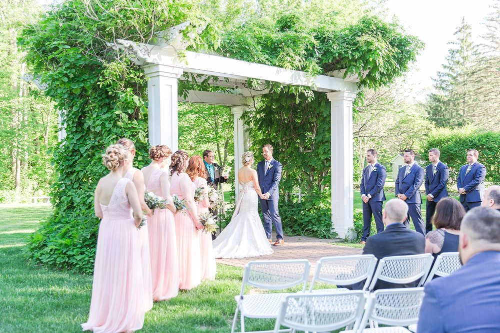fun-candid-laid-back-wedding-photos-at-wellers-carriage-house-in-saline-michigan-and-at-the-eagle-crest-golf-resort-by-courtney-carolyn-photography_0067.jpg