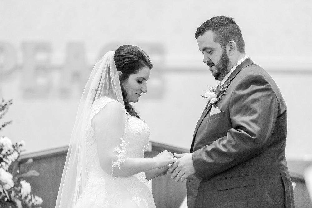 emotional-laid-back-romantic-wedding-photos-at-adrian-college-herrick-chapel-in-adrian-michigan-by-courtney-carolyn-photography_0028.jpg