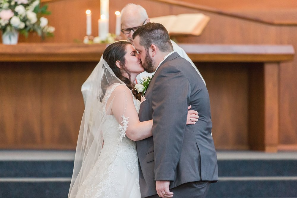 emotional-laid-back-romantic-wedding-photos-at-adrian-college-herrick-chapel-in-adrian-michigan-by-courtney-carolyn-photography_0030.jpg