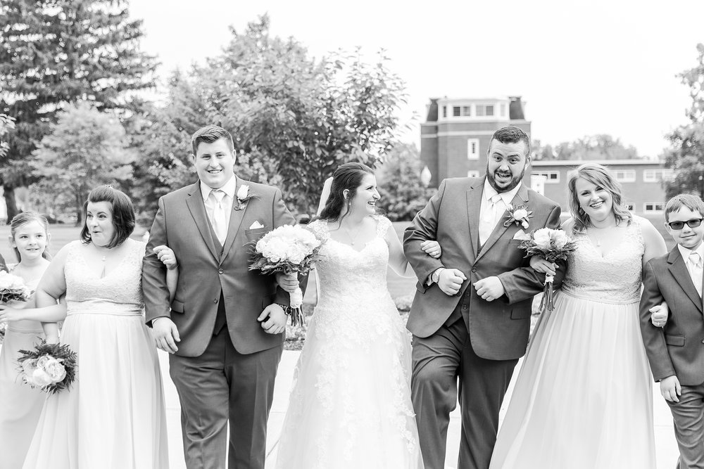 emotional-laid-back-romantic-wedding-photos-at-adrian-college-herrick-chapel-in-adrian-michigan-by-courtney-carolyn-photography_0056.jpg