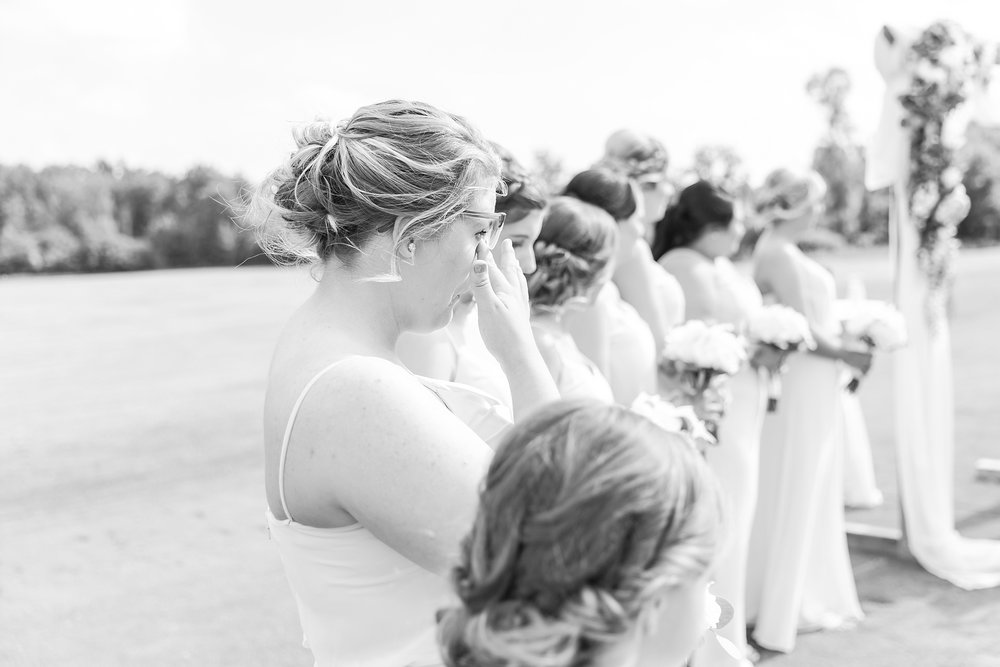 candid-timeless-wedding-photos-at-the-captains-club-in-grand-blanc-michigan-by-courtney-carolyn-photography_0037.jpg