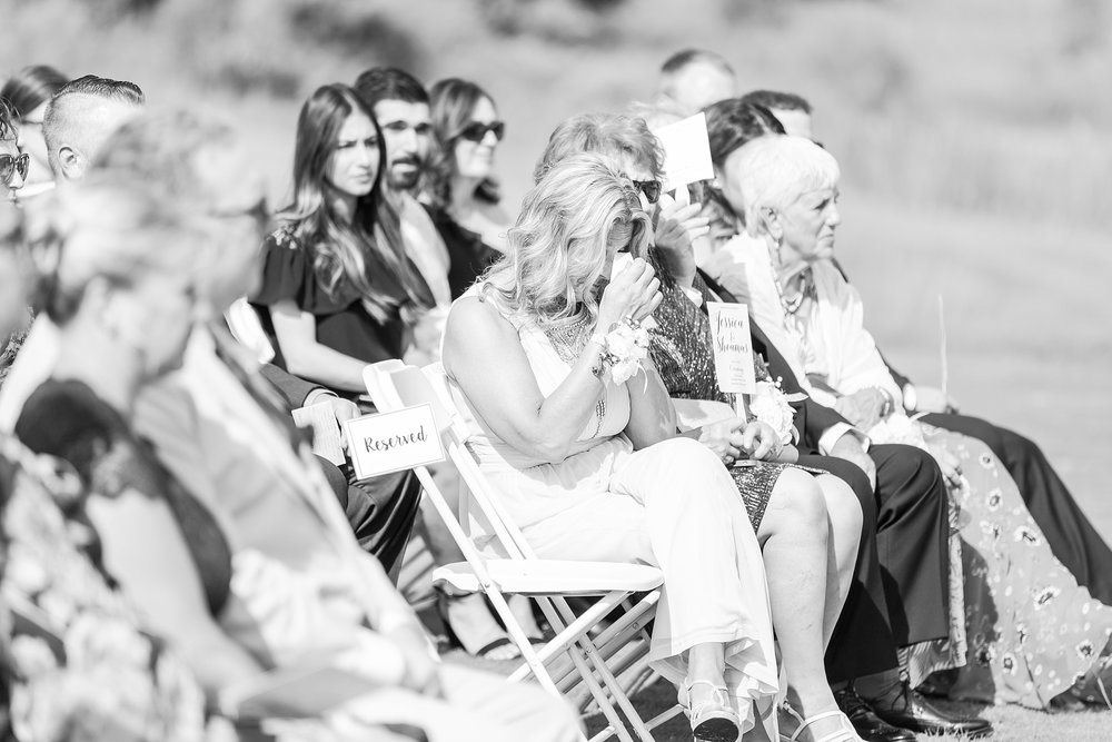 candid-timeless-wedding-photos-at-the-captains-club-in-grand-blanc-michigan-by-courtney-carolyn-photography_0040.jpg
