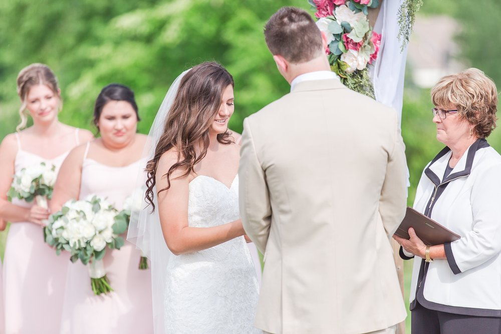 candid-timeless-wedding-photos-at-the-captains-club-in-grand-blanc-michigan-by-courtney-carolyn-photography_0046.jpg