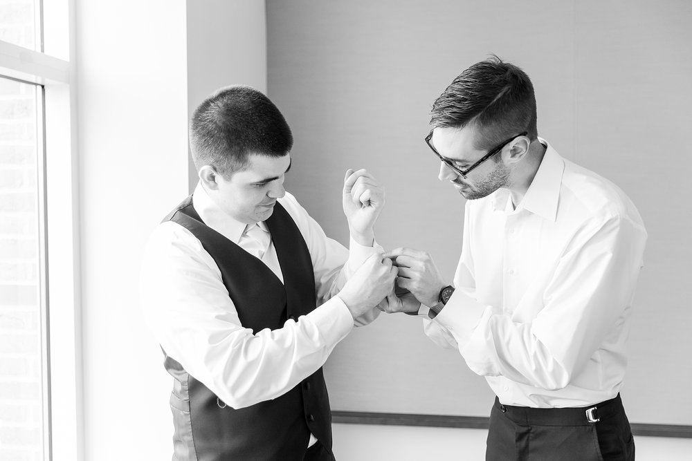 candid-romantic-wedding-photos-at-the-h-hotel-in-midland-michigan-by-courtney-carolyn-photography_0005.jpg