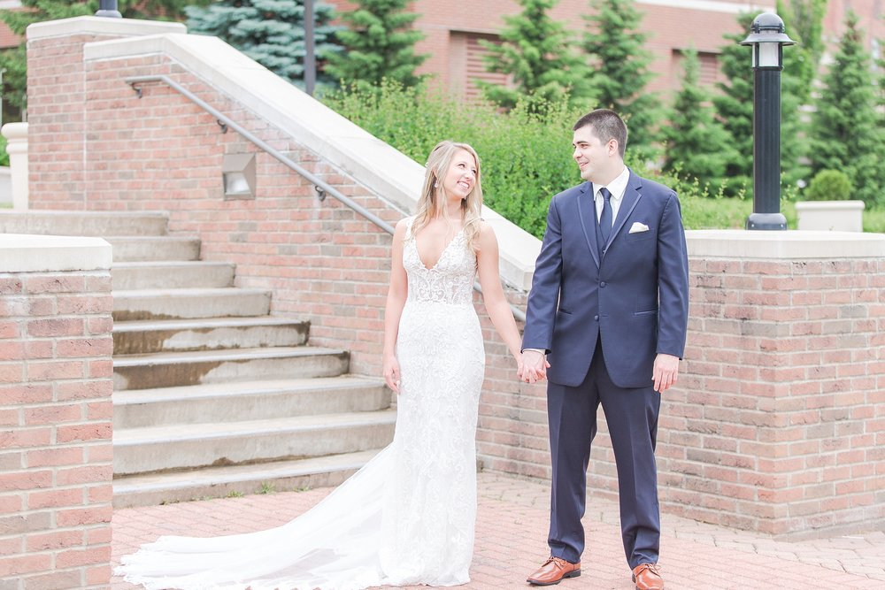 candid-romantic-wedding-photos-at-the-h-hotel-in-midland-michigan-by-courtney-carolyn-photography_0030.jpg