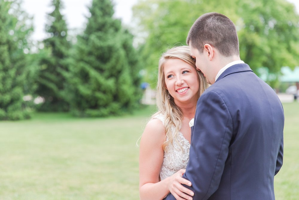 candid-romantic-wedding-photos-at-the-h-hotel-in-midland-michigan-by-courtney-carolyn-photography_0034.jpg