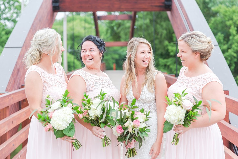 candid-romantic-wedding-photos-at-the-h-hotel-in-midland-michigan-by-courtney-carolyn-photography_0041.jpg