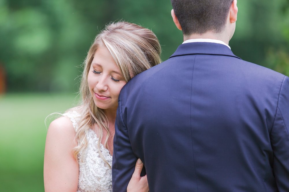 candid-romantic-wedding-photos-at-the-h-hotel-in-midland-michigan-by-courtney-carolyn-photography_0045.jpg