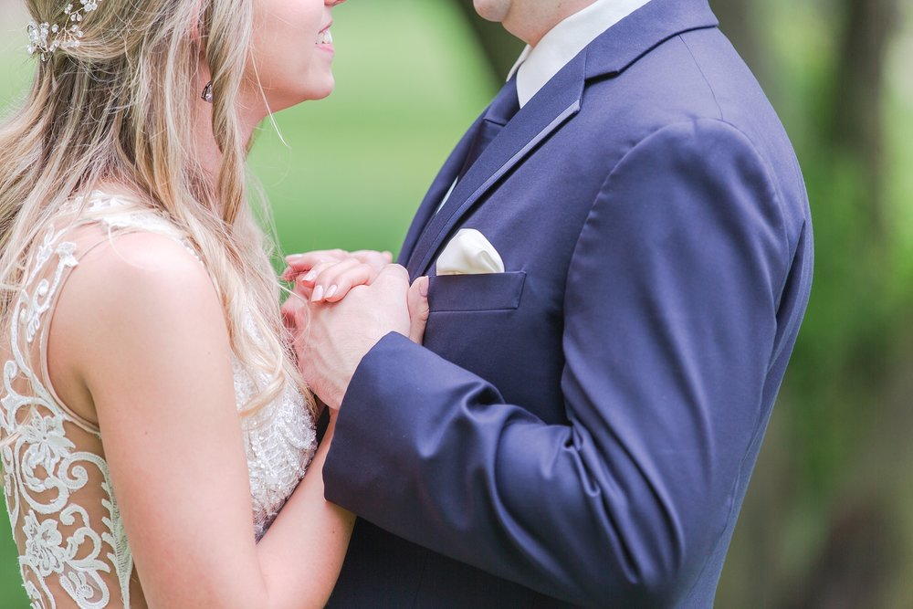 candid-romantic-wedding-photos-at-the-h-hotel-in-midland-michigan-by-courtney-carolyn-photography_0048.jpg