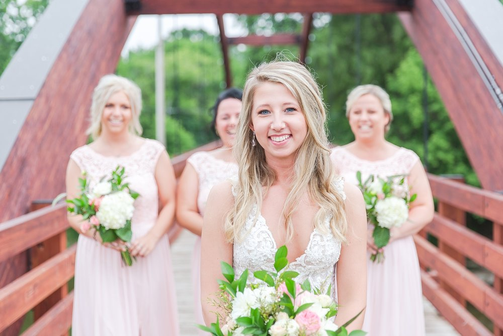 candid-romantic-wedding-photos-at-the-h-hotel-in-midland-michigan-by-courtney-carolyn-photography_0050.jpg