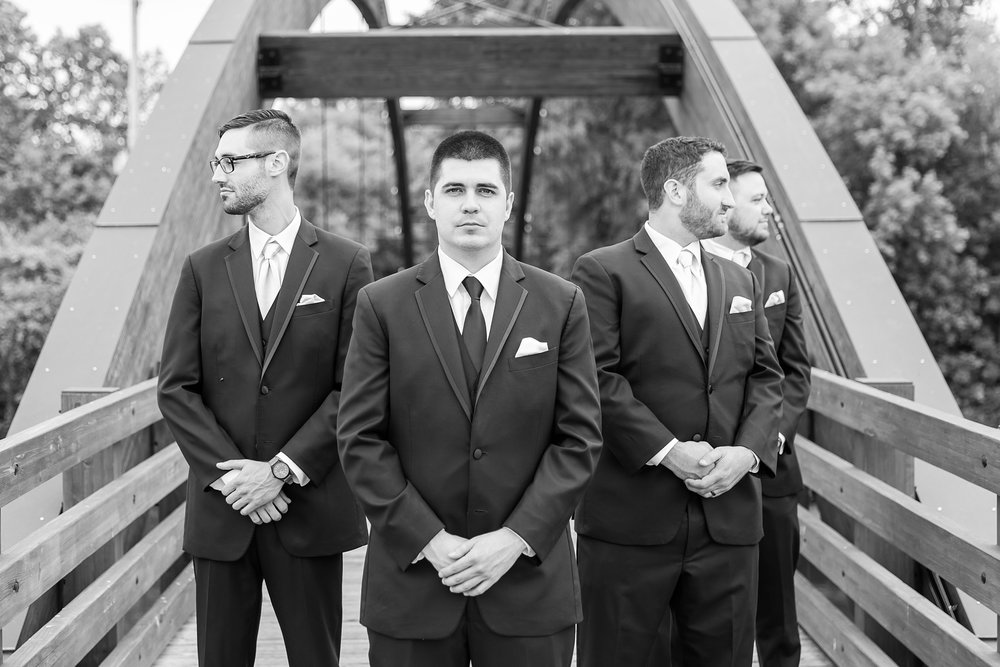 candid-romantic-wedding-photos-at-the-h-hotel-in-midland-michigan-by-courtney-carolyn-photography_0061.jpg