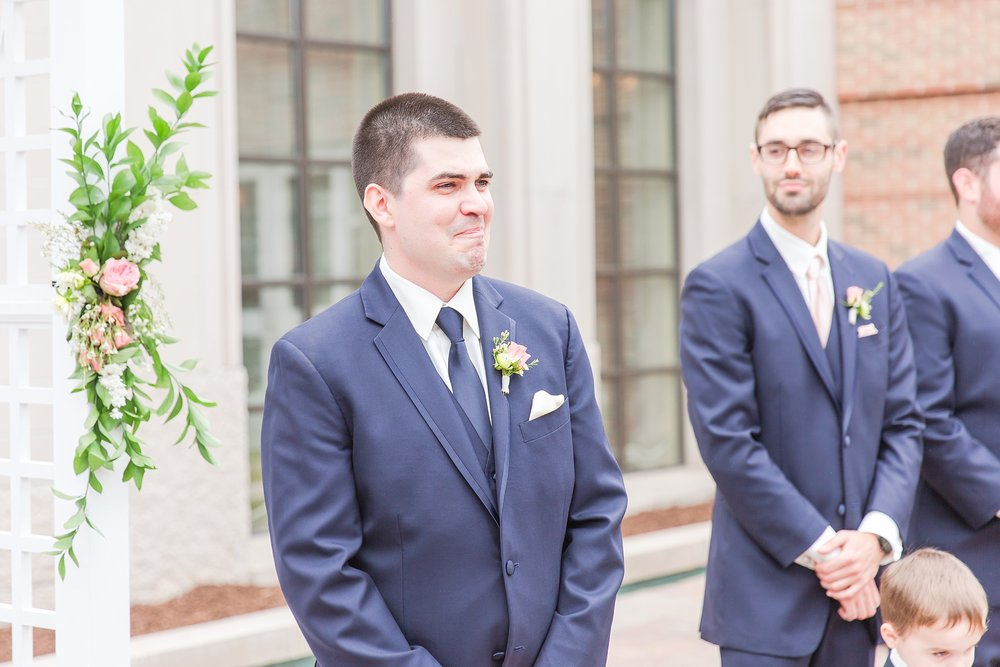candid-romantic-wedding-photos-at-the-h-hotel-in-midland-michigan-by-courtney-carolyn-photography_0063.jpg