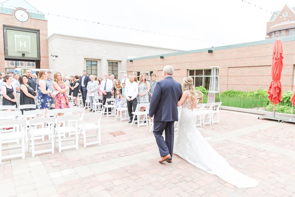 candid-romantic-wedding-photos-at-the-h-hotel-in-midland-michigan-by-courtney-carolyn-photography_0064.jpg