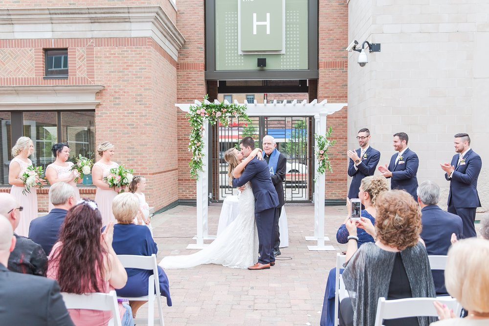 candid-romantic-wedding-photos-at-the-h-hotel-in-midland-michigan-by-courtney-carolyn-photography_0076.jpg