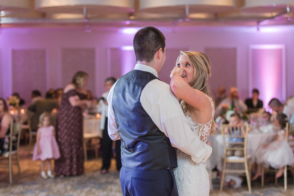 candid-romantic-wedding-photos-at-the-h-hotel-in-midland-michigan-by-courtney-carolyn-photography_0091.jpg