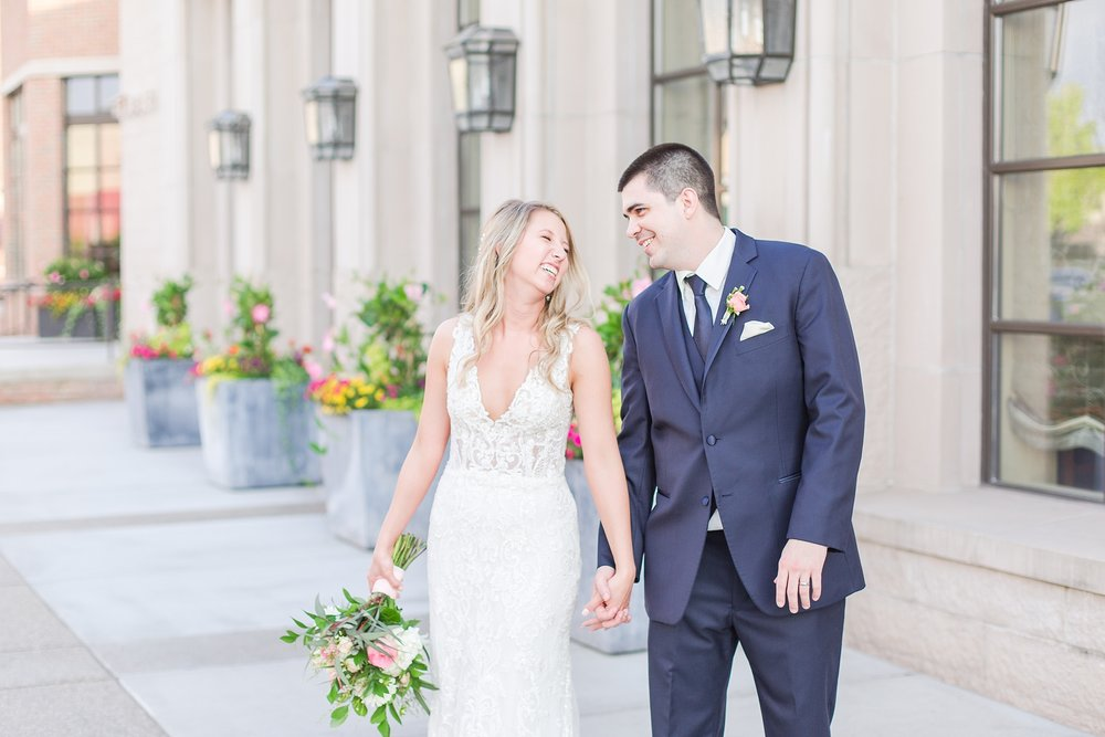 candid-romantic-wedding-photos-at-the-h-hotel-in-midland-michigan-by-courtney-carolyn-photography_0095.jpg