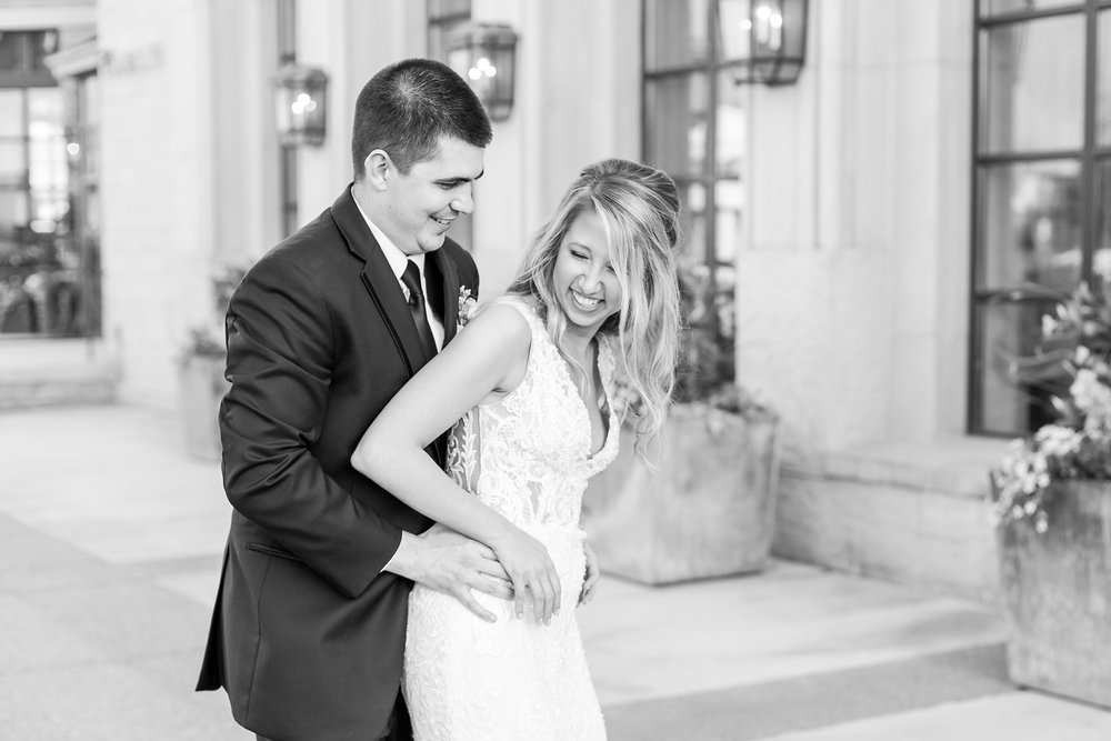 candid-romantic-wedding-photos-at-the-h-hotel-in-midland-michigan-by-courtney-carolyn-photography_0107.jpg