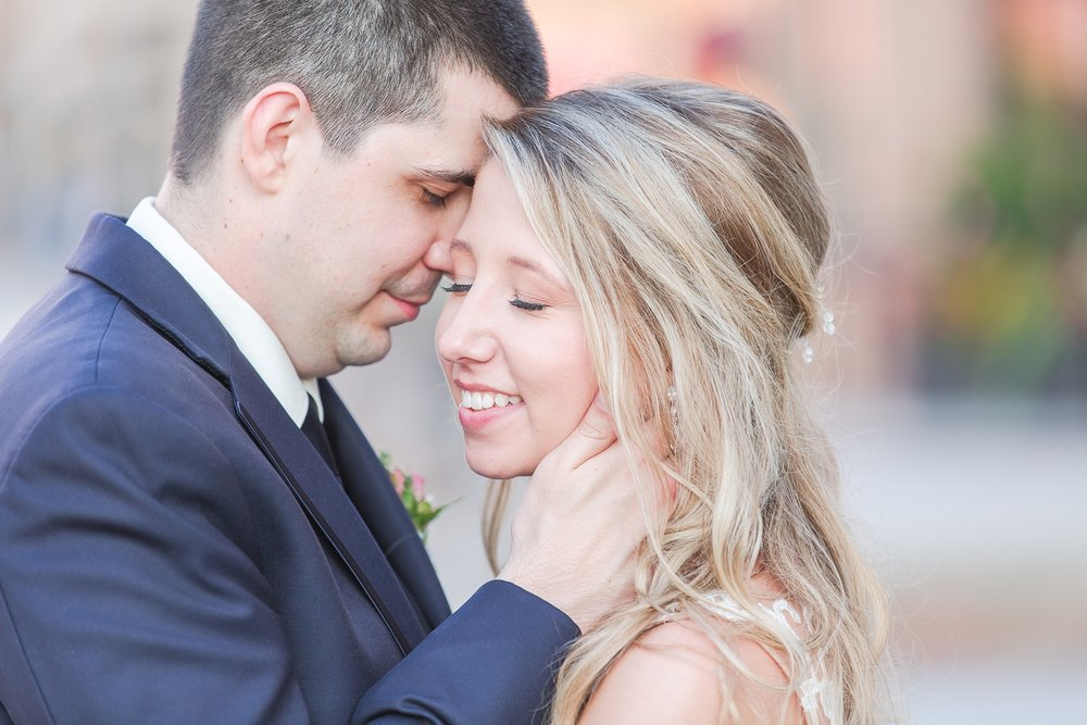 candid-romantic-wedding-photos-at-the-h-hotel-in-midland-michigan-by-courtney-carolyn-photography_0109.jpg