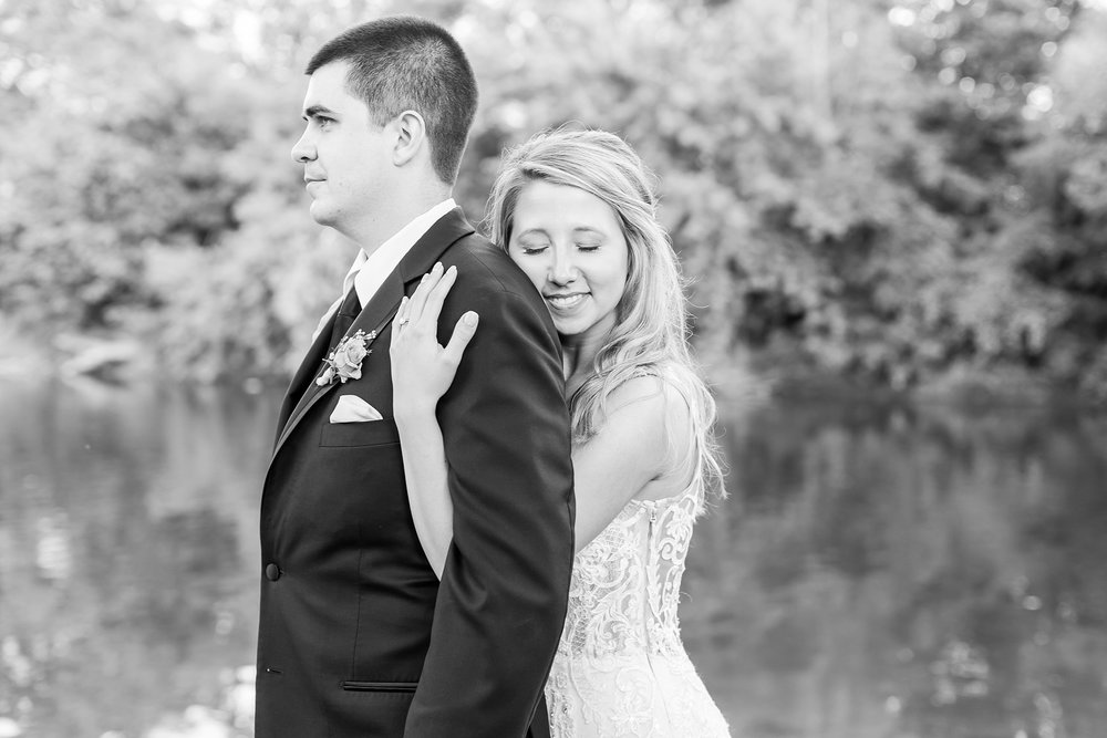 candid-romantic-wedding-photos-at-the-h-hotel-in-midland-michigan-by-courtney-carolyn-photography_0115.jpg