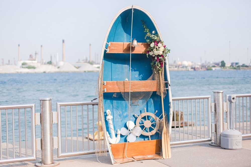 fun-nautical-wedding-photos-at-the-bean-dock-in-downtown-port-huron-michigan-by-courtney-carolyn-photography_0103.jpg