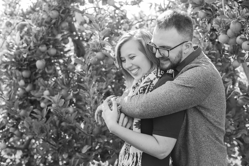 playful-fall-engagement-photos-at-hy's-cider-mill-ochard-in-bruce-township-michigan-by-courtney-carolyn-photography_0008.jpg