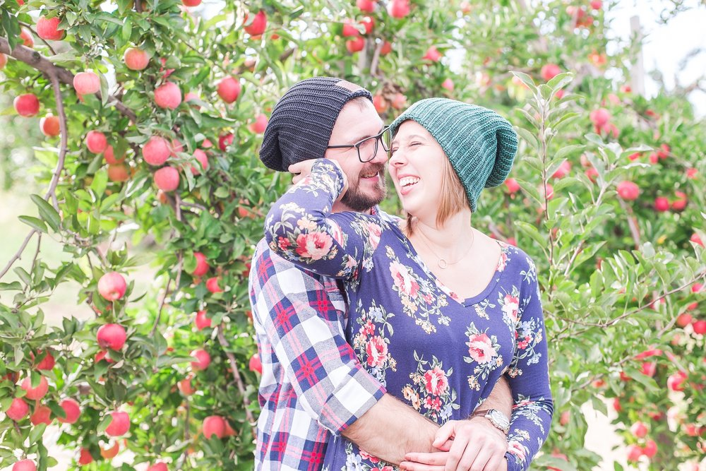 playful-fall-engagement-photos-at-hy's-cider-mill-ochard-in-bruce-township-michigan-by-courtney-carolyn-photography_0020.jpg