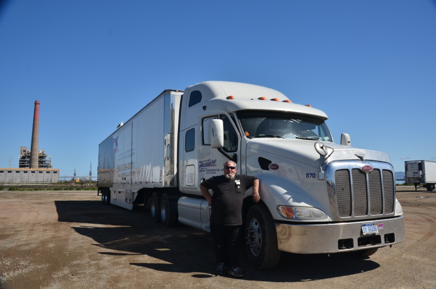 Jimmy Moore, 62, poses with his big rig truck in the Marshalling Yard, Pier 80, San Francisco, CA.