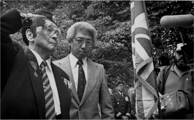 Masumi Mitsui, 98, salutes during the 1985 rededication ceremony for the Japanese Canadian War Memorial.