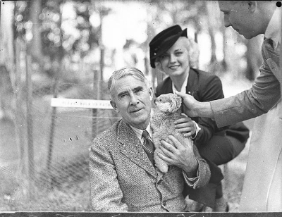 Zane Grey holding a koala during a visit to Australia.