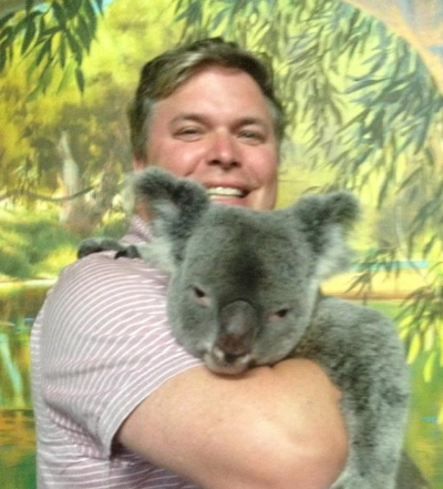 Our Ross holding a koala on his visit to Australia this past September.  Isn't the KOALA so cute?