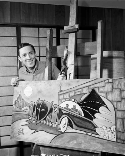 Bob Kane shown here with one of his Batman drawings.  Kane died in 1998 but Kane's work is still available for public viewing at the Museum of Modern Art in New York City  and other New York locations.