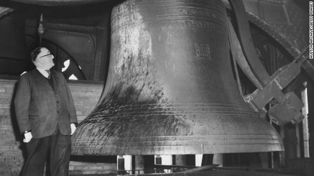 The size of Big Ben is clear by this unidentified man standing beside the enormous bell which weighs 13 tons.